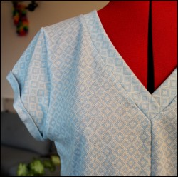 Fern and Thread Helens Blue Kommatia Tee with a Tie Front Hack Neckline and Sleeve turnup