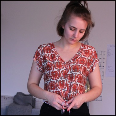 Fern and Thread Helens Kommatia Tee with a tie front hack in orange jersey